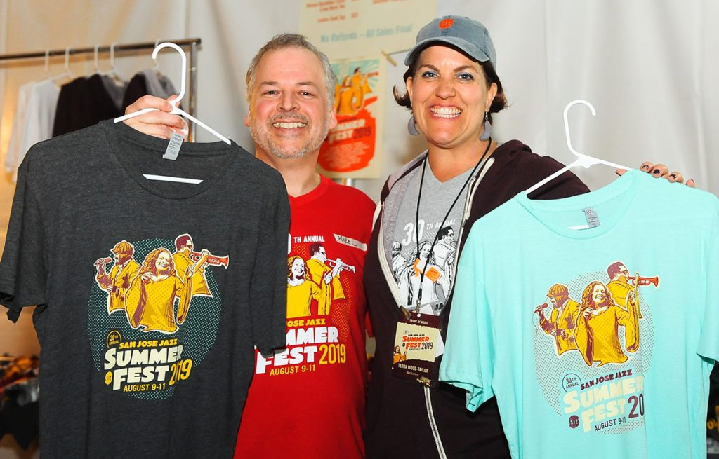 Staff show off our 2019 Official Fest Tee Shirt, from an illustration by local artist Ben Henderson. The design includes 30th Anniversary Fest headliners Gregory Porter and Dianne Reeves, plus Freddie Hubbard, who played Fest #1. Photo by Trisha Leeper